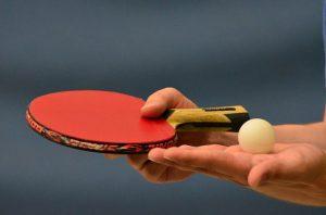 holding-a-ping-pong-bat